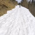 Continuing along the snowy road.- McCullough Gulch