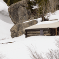 An old cabin buried in snow.- McCullough Gulch