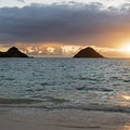 The sun rises with the Mokolua Islands each morning.- The Mokulua Islands