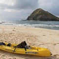 Paddling out to the Mokulua Islands.- The Mokulua Islands