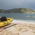 A little rainbow and a paddler enjoying his one-man outrigger.- The Mokulua Islands