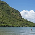 This is a great place to SUP because of the calm waters.- Kahana Bay Beach