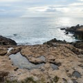 This beach park features a rocky shoreline.- Lualualei Beach Park