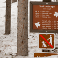 Trail mileage sign.- Emerald Lake Backcountry Tour