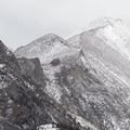 A closer look at Longs Peak shrouded in clouds.- Emerald Lake Backcountry Tour