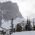 The sun pushing through the snow from behind Hallet Peak.- Emerald Lake Backcountry Tour