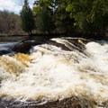 Twin Falls tumbles over several ledges.- Twin Falls