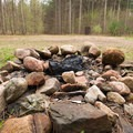 An upper clearing with a small fireplace and pit toilet.- Greenwood Creek Picnic Area