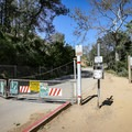 The trail begins by following the fire road behind the gate.- Hollywood Sign via Canyon Drive