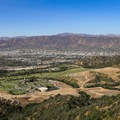 As the trail climbs toward the peak of Mount Lee, vistas over Burbank and the San Fernando Valley begin to open up.- Hollywood Sign via Canyon Drive