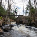 Crossing the small side channel.- Grass River's Rainbow Falls