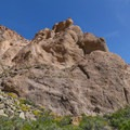 Near the top, the canyon walls open to colorful stone slopes lining the route.- Barker Ranch
