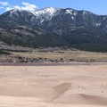 View of the sand dunes and the Sangre de Cristo Mountains separated by Medano Creek.- High Dune Loop