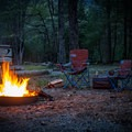 After wrapping up a Smoky Mountain sunset on Cades Cove Loop, get the campfire started and relax as night falls.  - Cades Cove Campground