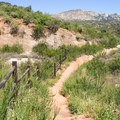 The trail follows a fence for a portion of the hike.- Horse Thief Loop + Historic Flume Trail