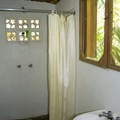 Simple and private bathrooms.- Clarissa Falls Resort