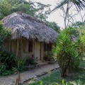 A thatched roof suite at Clarissa Falls Resort.- Clarissa Falls Resort