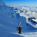 A climber takes in the view nearing the Queen's Chair.- Mount Hood: Leuthold Couloir