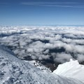 View to the west while climbing the Queen's Chair.- Mount Hood: Leuthold Couloir
