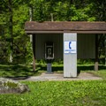Phone for emergency calls are located at the entrance of the campground. - Elkmont Campground