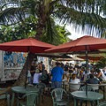 There are food trucks tucked off the main street.- Historic Hale'iwa Town