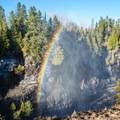 Mist creates a rainbow over the gorge.- Kakabeka Falls Provincial Park