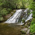 Indian Creek Falls is surrounded by beauty year around, and in May the falls are also surrounded by hundreds of butterflies.- Deep Creek Loop