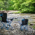 Pop up a chair and relax by the many tranquil water spots of Deep Creek!- Deep Creek Campground