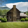 Located behind the Oconaluftee Visitor Center and next to the Oconaluftee River Trail is the Mountain Farm Museum. This is a perfect spot for families to explore!- Oconaluftee River Trail + Mountain Farm Museum