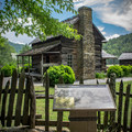 Explore the Mountain Farm Museum to get a glimpse into the Smokies of the past.- Oconaluftee River Trail + Mountain Farm Museum