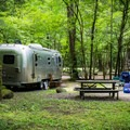 The campground offers both tent and RV sites.- Smokemont Campground