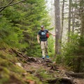 A portion of the trail follows the Appalachian Trail.- Lonesome Lake via Basin Cascade + Cascade Brook Trails