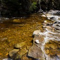 One of two stream crossings.- Lonesome Lake via Basin Cascade + Cascade Brook Trails