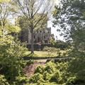 The castle through the trees.- Gillette Castle State Park