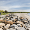 Large rocks placed along the coastline.- Sherwood Island State Park