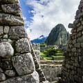 Between the walls of Machu Picchu, the striking peak of Huayna Picchu can be seen.- Machu Picchu via the Inca Trail