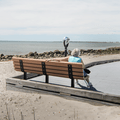 Benches line the walking paths and offer an opportunity to enjoy the ocean.- Silver Sands State Park