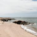 The sandy beach next to the lighthouse.- Lighthouse Point Park