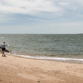 Visitors enjoying the beach.- Lighthouse Point Park