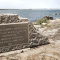 A commemorative plaque and pedestal where a cannon once sat.- Lighthouse Point Park