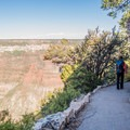The trail bends around beautiful rock walls.- Bright Angel Point