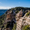 The North Rim Grand Canyon Lodge tucked away in the mountain.- Bright Angel Point