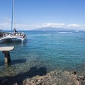 View of Lahaina Harbor with the island of Lanai in the distance.- Lahaina National Historic District