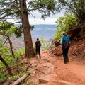 Walking along the rim on the North Kaibab Trail.- North Kaibab Trail to Roaring Springs