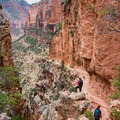 Trail wrapping around Eye of the Needle.- North Kaibab Trail to Roaring Springs