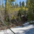 Snow can linger on parts of the trail well into spring.- Ken Patrick Trail