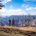 Pointing out landmarks on the opposite canyon rim in Grand Canyon National Park.- Ken Patrick Trail