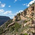The trail cuts across many rock layers on its climb to the rim.- Dripping Springs