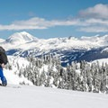 Climbing up Mount Brew with Whistler Blackcomb visible in the background.- Mount Brew