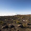 View west from the Haleakalā Visitor Center of the volcanoes arid summit landscape.- Haleakalā Visitor Center + Pā Ka'oao Trail